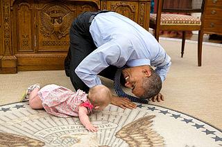 Barack Obama crawling with Ella Rhodes