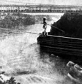Maria Spelterini crossing the Niagara gorge on a tightrope on July 4, 1876 caption for suspension bridge picture