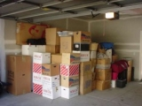 stacked-moving-boxes-in-garage-300x225